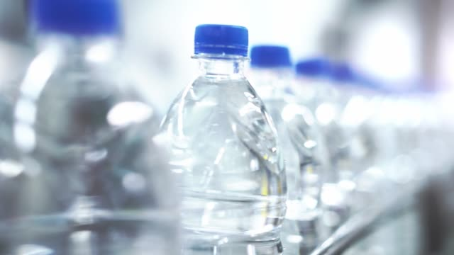 Clean water in plastic bottle moves through conveyor factory. Clean water in plastic bottle moves through conveyor factory bottle stock videos & royalty-free footage
