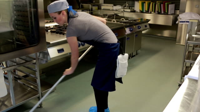 Cleaner of a kitchen wiping the floor video