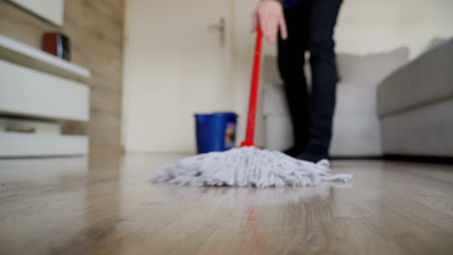 Cleaning a floor-close up video