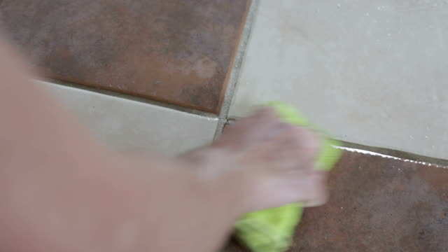 Cleaning Dirty Ceramic Mortar on the Floor with Products Cleaning Dirty Ceramic Mortar on the Floor with Products tile stock videos & royalty-free footage