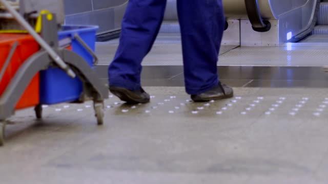 Cleaning floor in underground station.