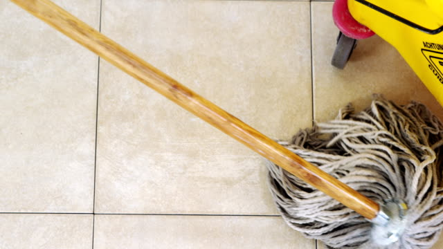 Cleaning floor using a mop video