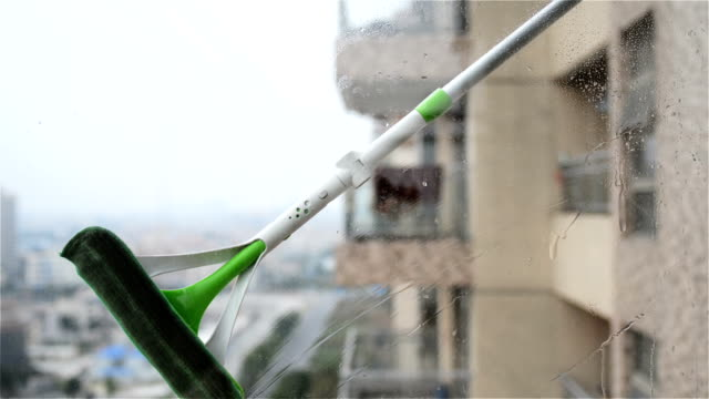 Cleaning glass window in an apartment video