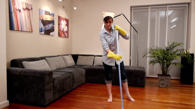 cleaning lady living room broom video