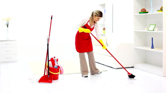 Cleaning lady tidying up a room. video