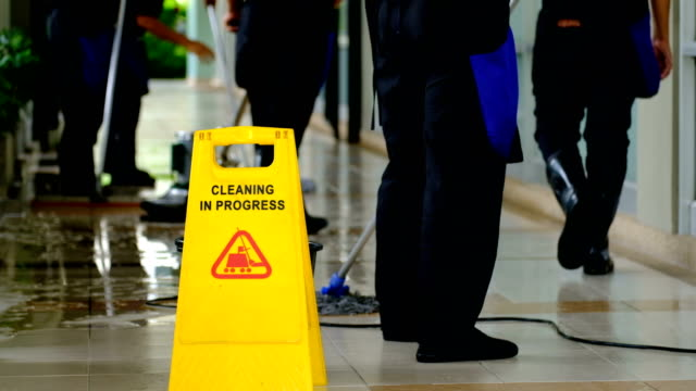 Cleaning service team cleaning floor with Scrubber machine and cleaning in process label video