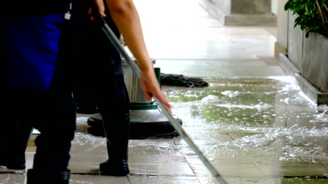 Cleaning service team cleaning floor with Scrubber machine and cleaning in process label 4k Cleaning service team cleaning floor with Scrubber machine cleaning stock videos & royalty-free footage