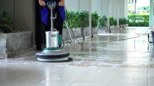 Cleaning service team cleaning floor with Scrubber machine and cleaning in process label Cleaning service team cleaning floor with Scrubber machine and cleaning cleaning stock videos & royalty-free footage