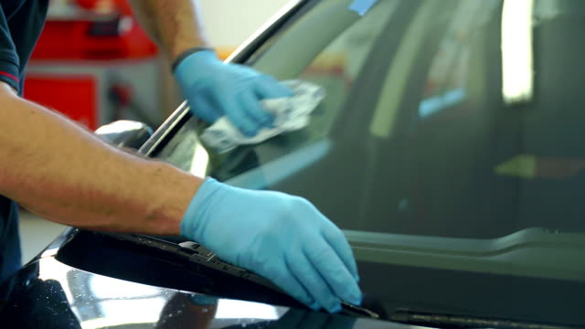 Cleaning the front window of a car after the problem has been taken care of video