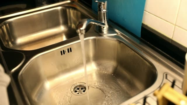 Cleaning the kitchen sink Doing the weekly chores to clean the kitchen sink properly and thoroughly. kitchen sink stock videos & royalty-free footage