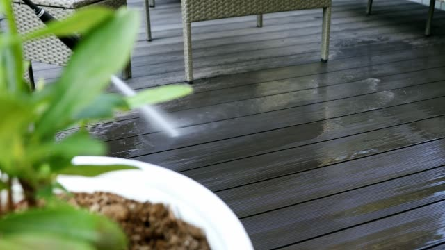 cleaning wood plastic composite terrace planks with high pressure washer