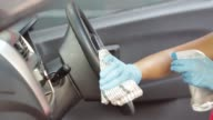 istock Cleansing car interior and spraying with disinfection liquid. Hands in rubber protective glove disinfecting vihicle inside for protection from virus corona disease 1213228229