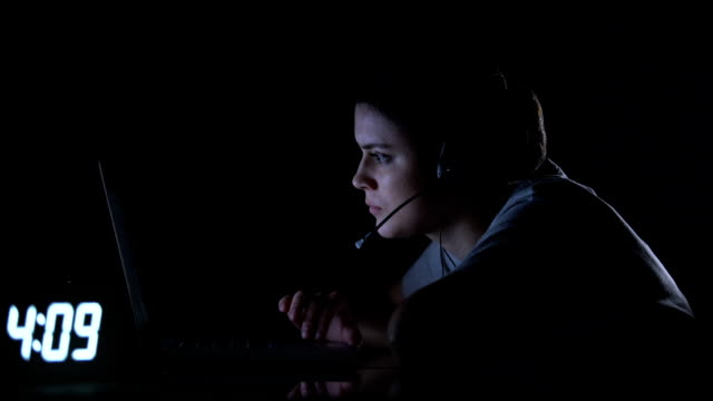 client support female employee working at night shift, unhealthy life regime - shifts call centre video stock e b–roll