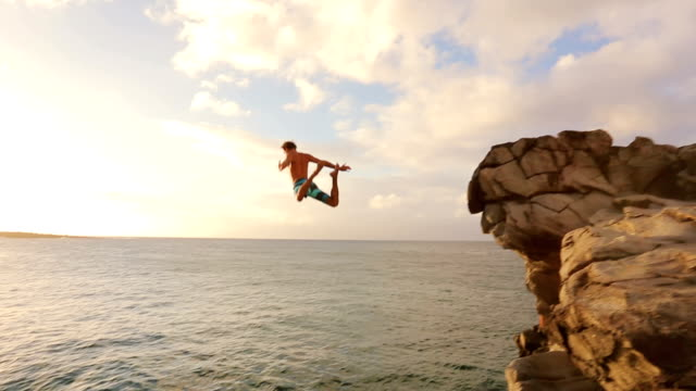 Cliff Jumping at Sunset into Ocean. video