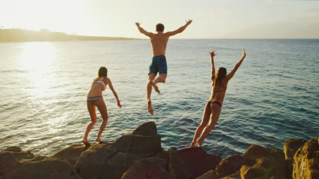 cliff jumping at sunset - cliffs stock videos & royalty-free footage