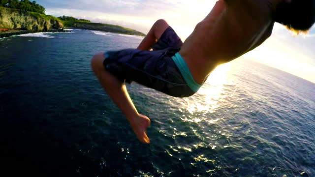 POV Cliff Jumping Backflip Gainer POV Cliff Jumping Backflip Gainer (Super Slow Motion) cliff jumping stock videos & royalty-free footage