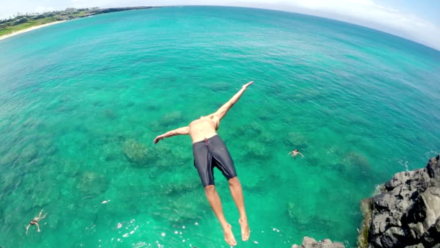 Cliff Jumping Backflip in HD Slow Motion. Young Man Back Flips off Cliff Into Water. Summer Extreme Sports Fun Lifestyle. (Slow Motion) cliff jumping stock videos & royalty-free footage