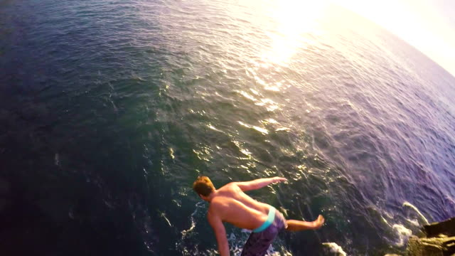 POV Cliff Jumping Backflip POV Cliff Jumping Backflip Gainer (Slow Motion) cliff jumping stock videos & royalty-free footage