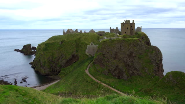 Cliffs and Castle on the coast of Scotland Cliffs and Castle on the coast of Scotland scotland stock videos & royalty-free footage