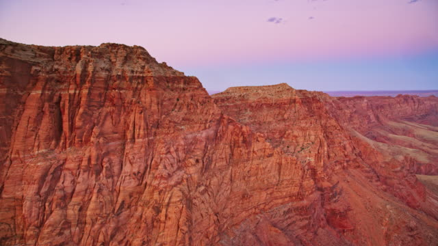 AERIAL Cliffs of  mountains in Grand Canyon at sunset