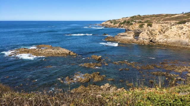 Cliffs on the beach Vila Nova de Milfontes video