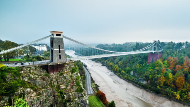 Clifton Suspension Bridge Day to night time-lapse of Clifton Suspension Bridge, River Avon, Bristol, England. Very foggy autumn evening. suspension bridge stock videos & royalty-free footage