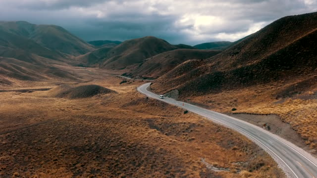 climate aerial view of mountain road - drone footage stock videos & royalty-free footage