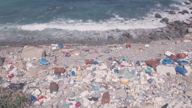 Climate change environmental impact of beach covered in plastic and rubbish in Hong Kong. Aerial drone view