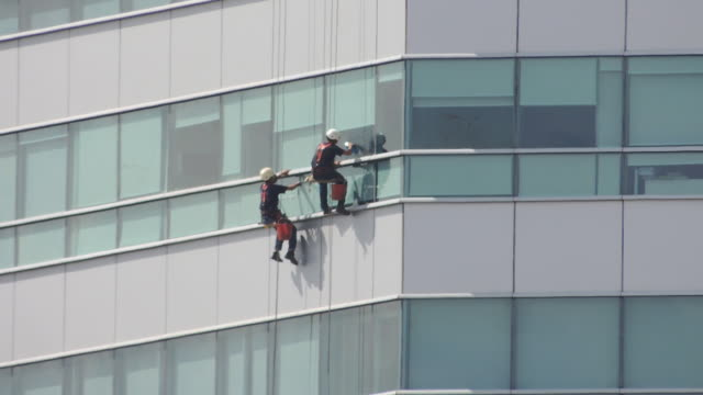 Climber cleaning modern building video