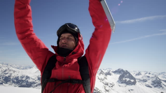 Climber is cheering on a mountain peak video