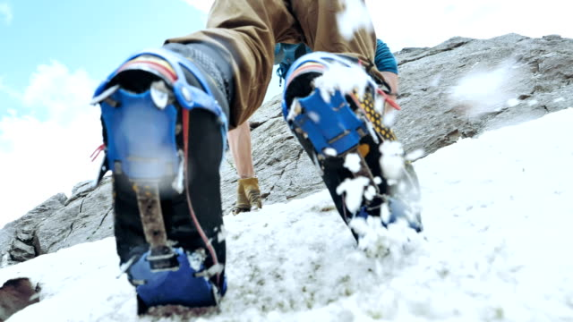 climber on a rock wall. caucasus mountains. equipment details - альпинизм стоковые видео и кадры b-roll