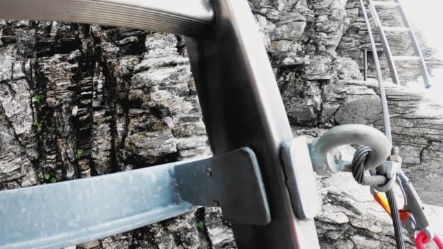 pov klättrare på via ferrata klättra upp för en stege - wengen bildbanksvideor och videomaterial från bakom kulisserna