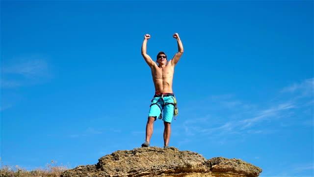 Climber Raising Hands video