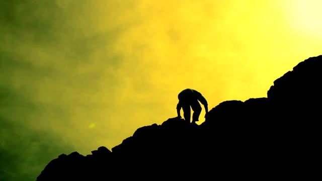 Climber Reaching Top of a Mountain Raising Hands Success HD