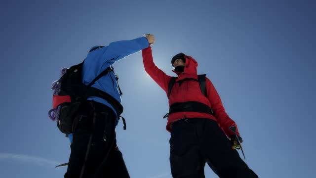 Climbers are cheering on a mountain peak video