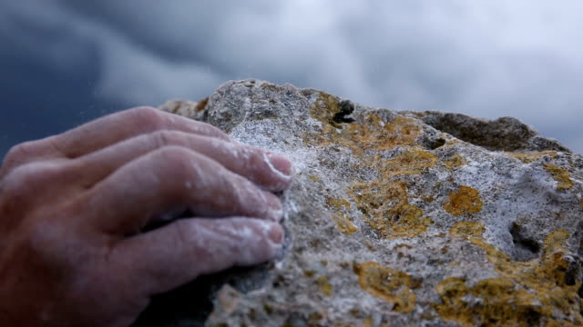Climber's hands grapple with final rock holds video