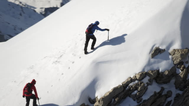 Climbers on a snow-covered mountain