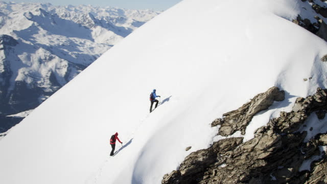 Climbers on a snow-covered mountain video