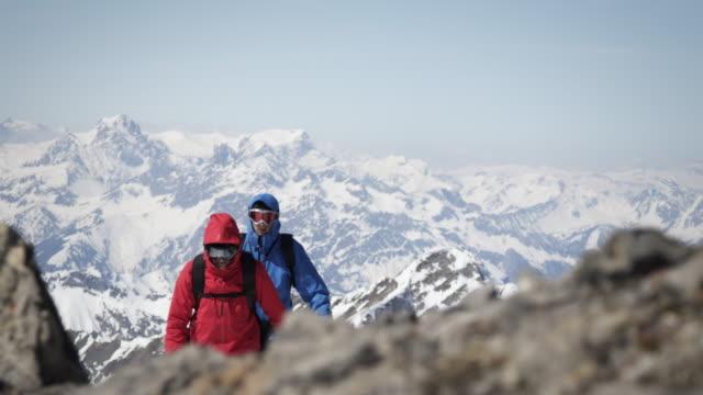 Climbers walk on a mountain video