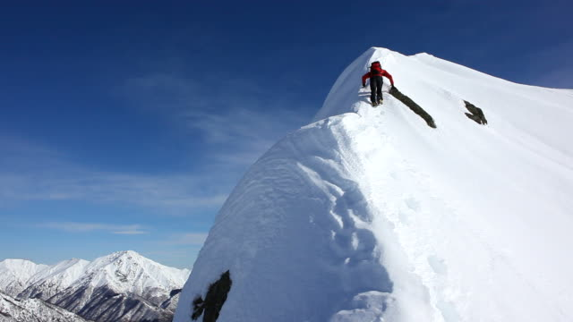 Climbing a snowy ridge - HD1080p video