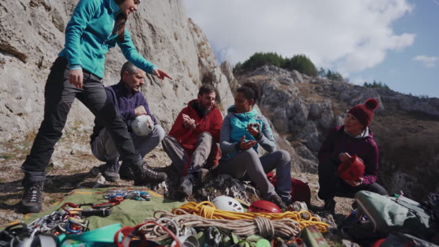 Climbing coach giving instruction about climbing safety