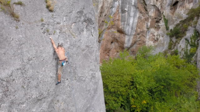 climbing high - rock climbing stock videos and b-roll footage