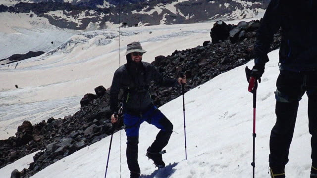 Climbing on a snowy slope. Training safe descent