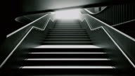 istock Climbing the black stairs to white light. Ambitions concept. 933093394