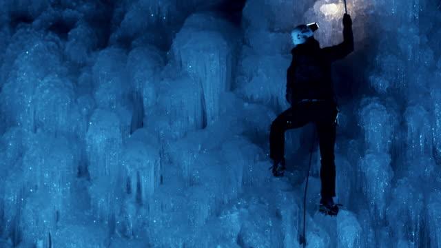 climbing the ice at night - eisklettern stock-videos und b-roll-filmmaterial