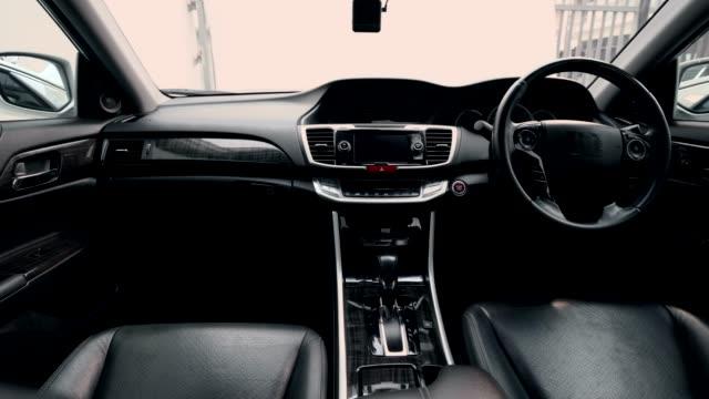 4k klipp film interiör modern bil, svart lädersits inuti. - wheel black background bildbanksvideor och videomaterial från bakom kulisserna
