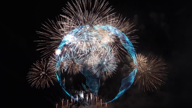 4k clip of multicolor firework celebration over the part of abstract planet earth particle background, independence day concept - luglio video stock e b–roll