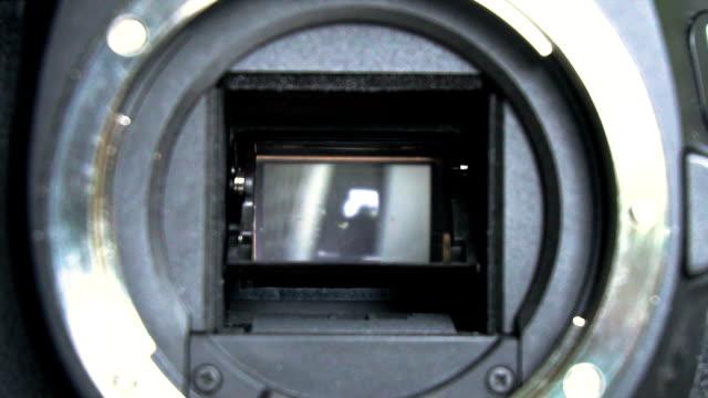 stockvideo's en b-roll-footage met 3 clips - digitale camera sluiter en cmso sensor slowmotion - photography curtains