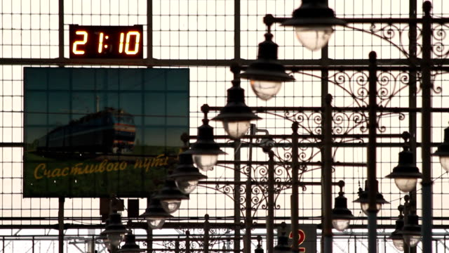 Clock and picture inside the Kiev Railway Station in Moscow video