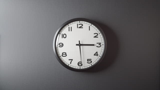 Clock Face Full Circle 12 hours on dark grey background in time lapse 6.4 Clock Face Full Circle 12 hours on dark grey background in time lapse clock stock videos & royalty-free footage